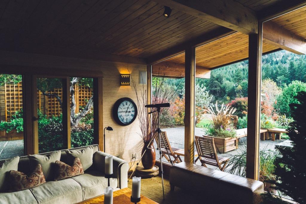 A Living Room Overlooking A Backyard